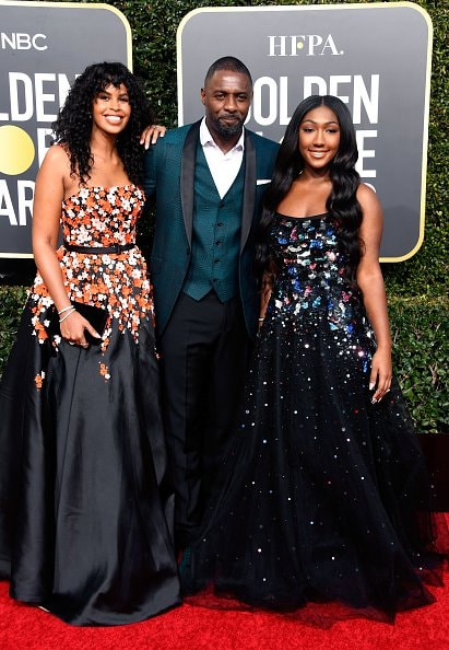 BEVERLY HILLS, CA - JANUARY 06:  (L-R) Sabrina Dhowr, Idris Elba, and Isan Elba attend the 76th Annual Golden Globe Awards at The Beverly Hilton Hotel on January 6, 2019 in Beverly Hills, California.  (Photo by Frazer Harrison/Getty Images)