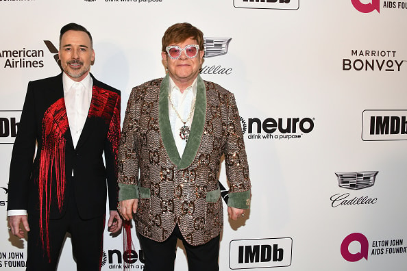 WEST HOLLYWOOD, CA - FEBRUARY 24: David Furnish and Sir Elton John attend the 27th annual Elton John AIDS Foundation Academy Awards Viewing Party celebrating EJAF and the 91st Academy Awards on February 24, 2019 in West Hollywood, California.  (Photo by Araya Diaz/Getty Images for Marriott Bonvoy)
