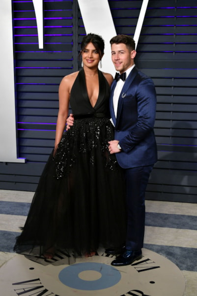 BEVERLY HILLS, CA - FEBRUARY 24:  Priyanka Chopra (L) and Nick Jonas attend the 2019 Vanity Fair Oscar Party hosted by Radhika Jones at Wallis Annenberg Center for the Performing Arts on February 24, 2019 in Beverly Hills, California.  (Photo by Dia Dipasupil/Getty Images)