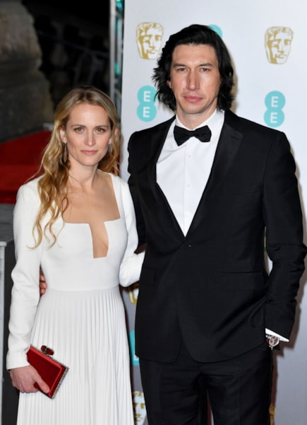 LONDON, ENGLAND - FEBRUARY 10:  Adam Driver (R) and Joanne Tucker attend the EE British Academy Film Awards at Royal Albert Hall on February 10, 2019 in London, England. (Photo by Pascal Le Segretain/Getty Images)