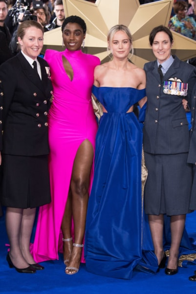 """LONDON, ENGLAND - FEBRUARY 27: Lashana Lynch and Brie Larson with British Servicewomen as they attend the """"Captain Marvel European Gala"""" held at The Curzon Mayfair on February 27, 2019 in London, England. (Photo by Jeff Spicer/Getty Images)"""