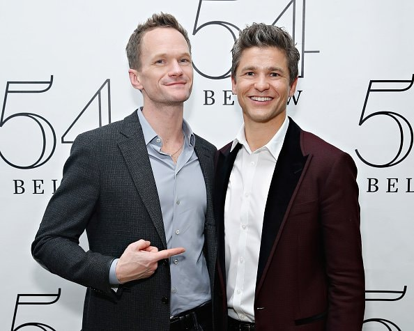 NEW YORK, NY - NOVEMBER 25:  Actor David Burtka (R) poses for a photo backstage with husband actor Neil Patrick Harris (L) following his performance at 54 Below on November 25, 2014 in New York City.  (Photo by Cindy Ord/Getty Images for 54 Below)