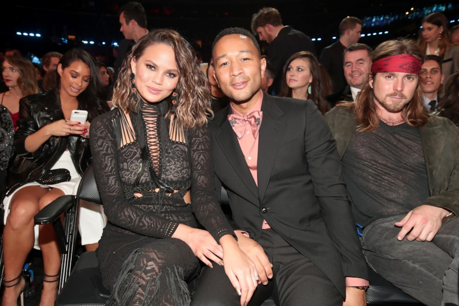 LOS ANGELES, CA - FEBRUARY 12:  Media Personality Chrissy Teigen (L) and singer John Legend during The 59th GRAMMY Awards at STAPLES Center on February 12, 2017 in Los Angeles, California.  (Photo by Christopher Polk/Getty Images for NARAS)