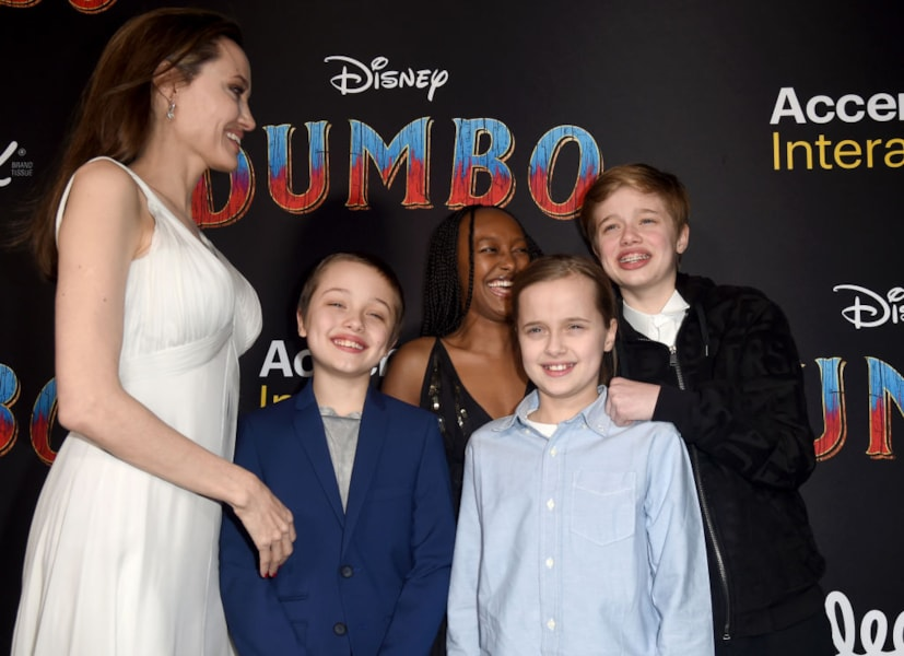 """LOS ANGELES, CALIFORNIA - MARCH 11: Angelina Jolie, Knox Leon Jolie-Pitt, Zahara Marley Jolie-Pitt, Vivienne Marcheline Jolie-Pitt, and Shiloh Nouvel Jolie-Pitt attend the premiere of Disney's """"Dumbo"""" at El Capitan Theatre on March 11, 2019 in Los Angeles, California. (Photo by Kevin Winter/Getty Images)"""