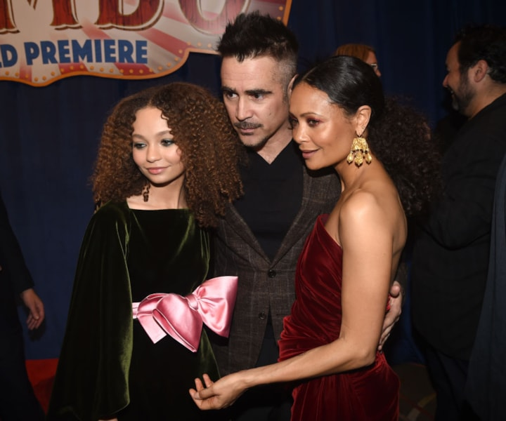 """LOS ANGELES, CALIFORNIA - MARCH 11: (L-R) Nico Parker, Colin Farrell, and Thandie Newton attend the premiere of Disney's """"Dumbo"""" at El Capitan Theatre on March 11, 2019 in Los Angeles, California. (Photo by Kevin Winter/Getty Images)"""