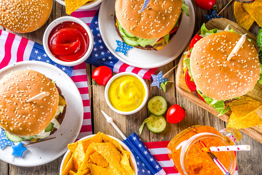 Patriotic Picnic with burgers, french fries and snacks, Summer USA picnic and bbq concept, Old wooden background